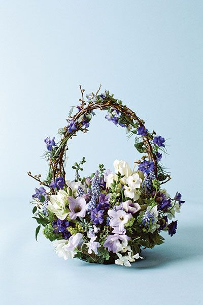Françoise Weeks   witch hazel branches, rosary vine, tulips, anemones, sweet peas, paperwhites, muscari, hellebores, alchemilla, freesia, succulents, cyclamen foliage, larkspur
