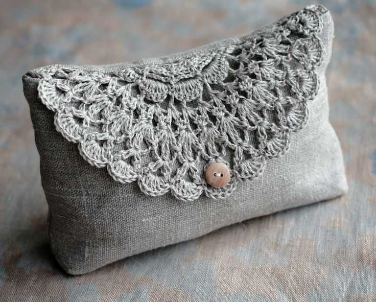 Linen clutch with crochet embelishment.....