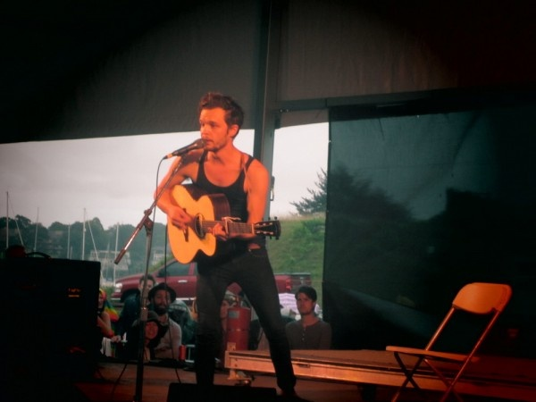 Tallest Man on Earth performs perhaps one of the most memorable sets at Newport Folk Festival, draws crowds that spill onto the surrounding hills in the rain to hear Kristian's poetic and beautiful folk songs.