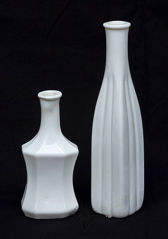 Two Figural Cologne Bottles, probably Boston and Sandwich Glass Works, Sandwich, Massachusetts, 1860-1880. Obelisk form with broad vertical ribs down the center of each side and polygonal form, milk glass, tooled flared mouths - smooth bases, ht. 4 5/8 inches and 7 1/4 inches. Form similar to MW plate 112, #12 and MW plate 113, #6 Fine condition. Ralph Finch collection. #Bottles #Figurals #MADonC