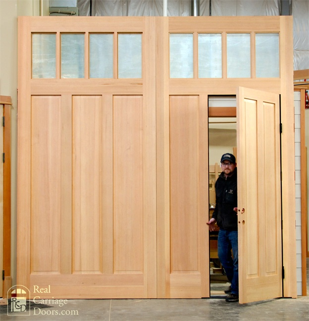 Carriage Style Garage Doors With Small Door For Easy Access.