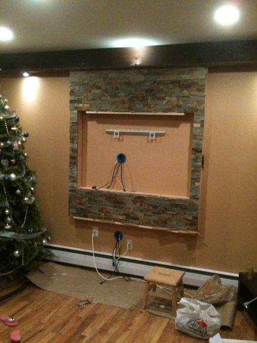 TV wall mount and entertainment center, Wall framed and covered in natural stone for my massive 55 inch HDTV, the natural stone being attach...