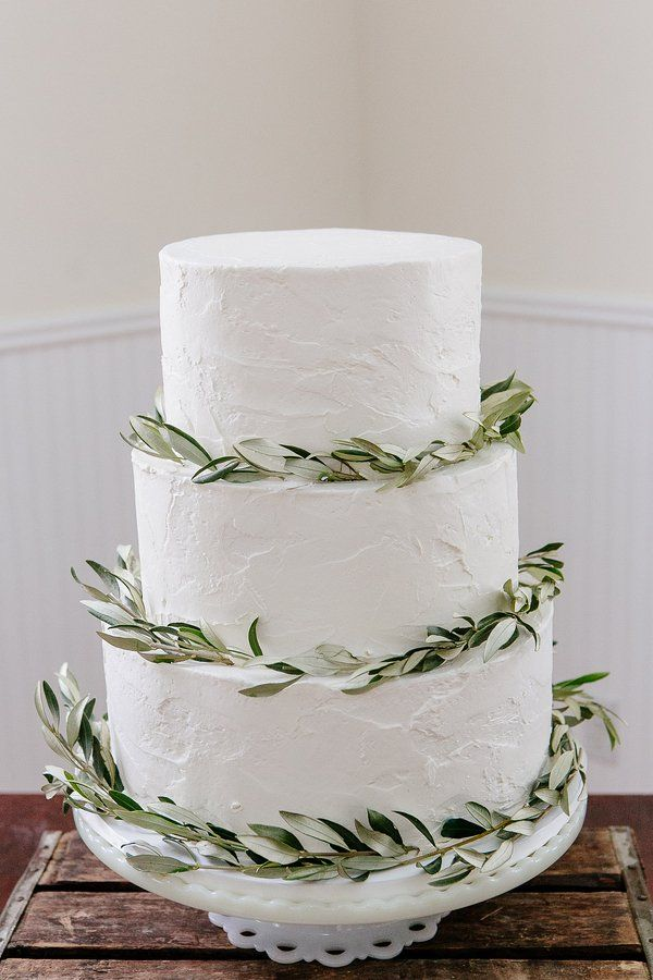 White & Green Wedding Cake with olive wreath