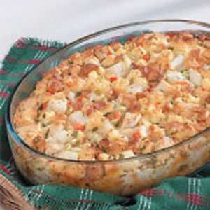 Hearty Chicken Strata Recipe - bread cubes, cooked chicken (ham?), potatoes, celery, carrots, milk, chicken broth, eggs, spices