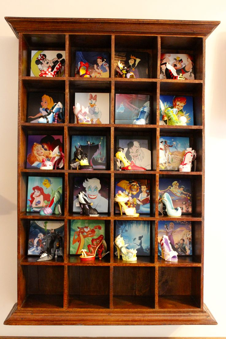 Last year in Disney World I purchased all of the adorable Disney Shoe Ornaments. I've been trying to figure out how to display them, finally decided on this antique mail sorter, I added some decoupage images from the movies and tada!