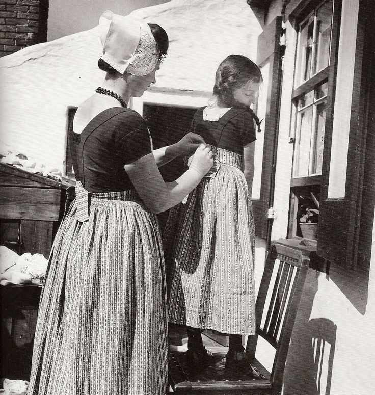 Dutch girl getting a new skirt by Eva Besnyö, 1930s Westkapelle Zeeland