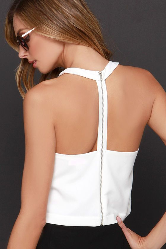 With so many chic pieces coming and going, you're going to want to hurry over to claim your very own Race Ya Ivory Crop Top! This woven racer-front top has deep cut arm openings that rest above the cropped bodice with darted detail. The halter neck drops to a T-strap back finished with an exposed gold zipper. Fully lined. Self: 60% Polyester, 35% Cotton, 5% Spandex. Lining: 100% Polyester. Hand Wash Cold.