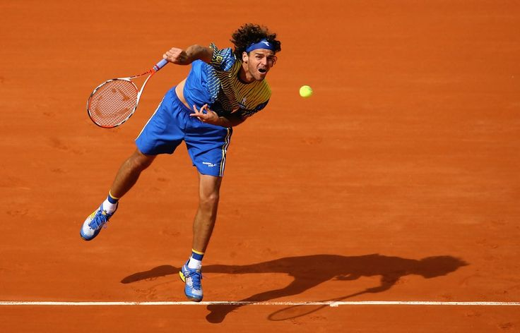 Gustavo Kuerten Photos Photos - Gustavo Kuerten of Brazil serves during the Men's Singles first round match against Paul-Henri Mathieu of France on day one of the French Open at Roland Garros on May 25, 2008 in Paris, France. The French Open with be Kuertens last tournament before retiring - French Open - Roland Garros 2008