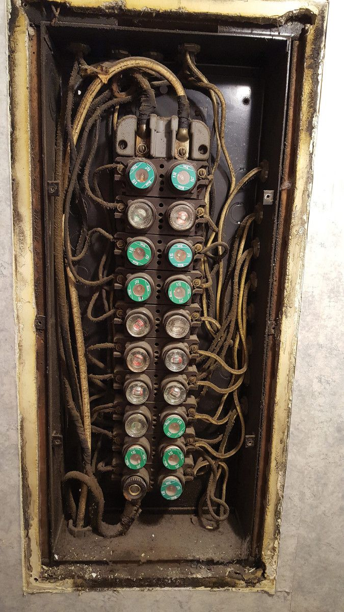 this old fuse box is loaded with obsolete wiring and it lacks adequate insulation  [ 675 x 1200 Pixel ]
