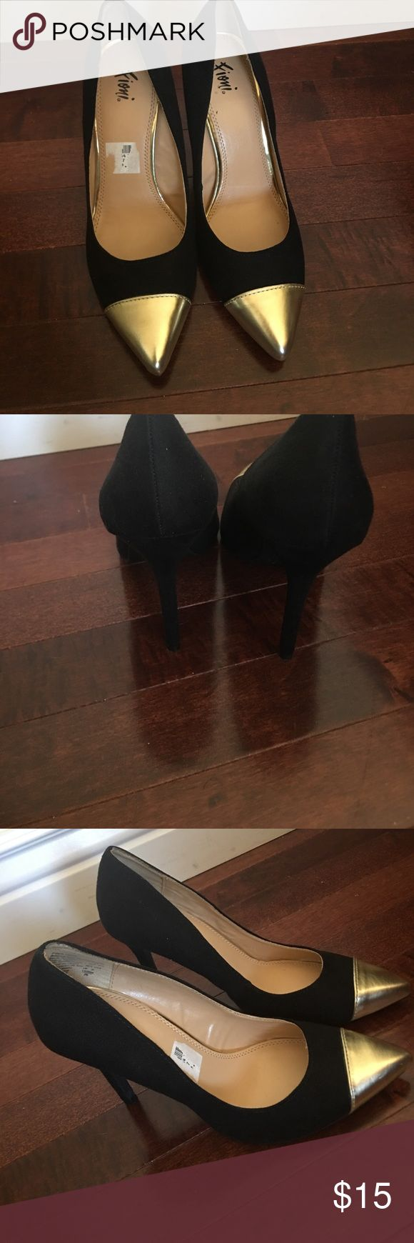 Fioni Heels with gold tip Almost brand new like pointed toe pumps.  only worn twice. They are perfect for parties, high heels and pointed toe. Purchased them from payless shoe source Payless Shoes Heels