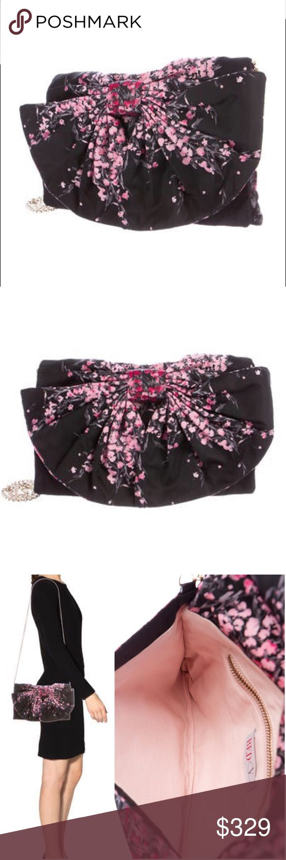"""💞Authentic Red Valentino Bow  floral printed bag❣ Black and pink floral printed woven Red Valentino crossbody bag with gold-tone hardware, single chain-link shoulder strap, large bow accent at flap, pink canvas lining, single interior zip pocket and magnetic snap closure at front flap. Includes dust bag.  Shoulder Strap Drop: 20"""" Height: 7.5"""" Width: 11"""" Depth: 0.5"""" NWOT - perfect fun and feminine bag! RED Valentino Bags"""
