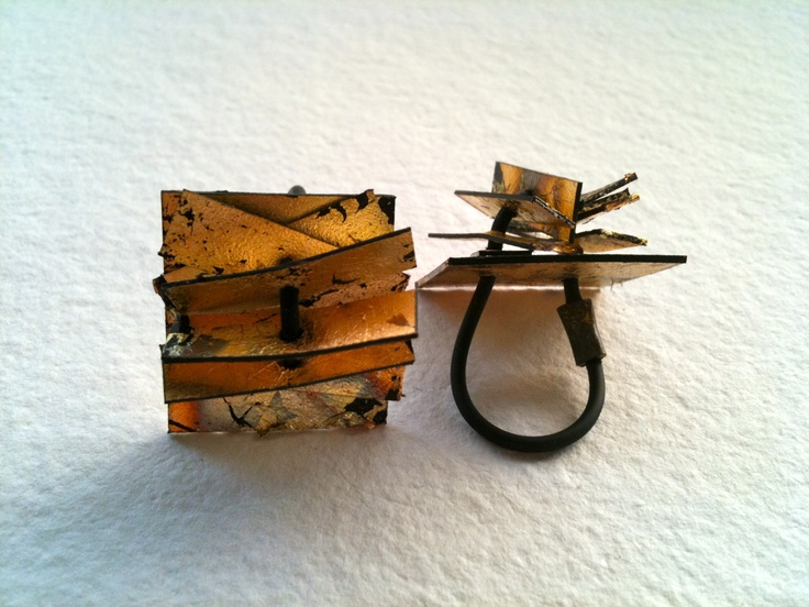 Kikis Alamo-art works-. Ring. Plastic, paper gold.