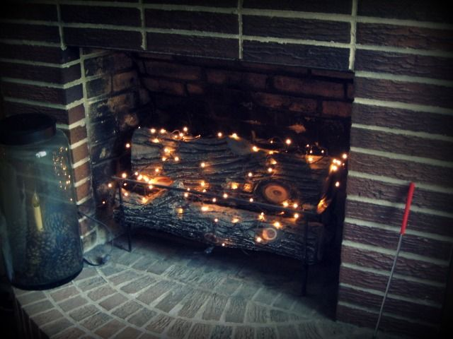 fireplace lighting. add a string or two of twinkle lights in the fireplace to soft glow lighting w