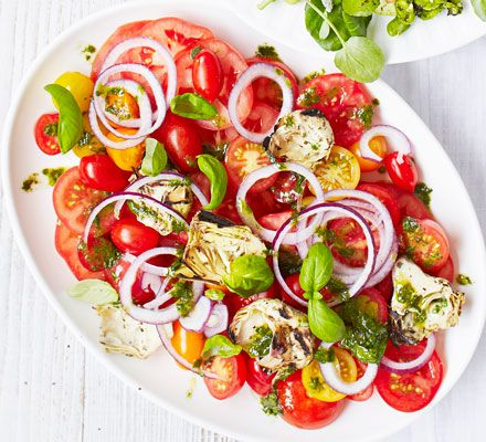 Put ripe and juicy tomatoes centre-stage in this simple side dish, dressed with basil oil - perfect with grilled or barbecued meats