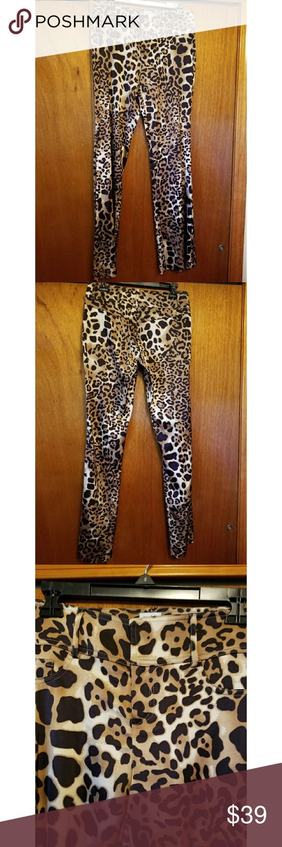 Weekend sale thru 6/4. Cache Leopard pants Brown leopard stretchy, fitted bootleg pants. Very sexy. Wore twice. No damage. Make offer. Cache Pants Boot Cut & Flare