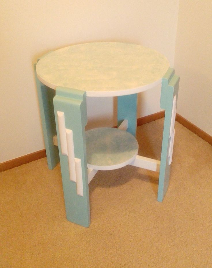 Retro inspired table in torquoise and cream with marbled top and lower shelf.