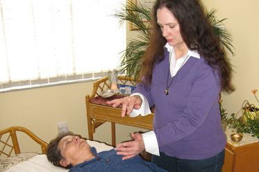 A practitioner's hands will rest on your body; or they may work above it in your energy field
