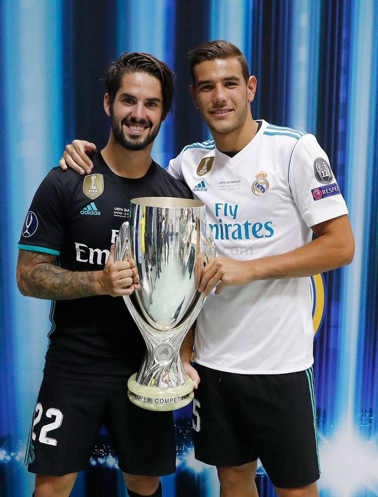 isco alarcon and kiko casilla holding UEFA SUPERCUP 2017 Trophy