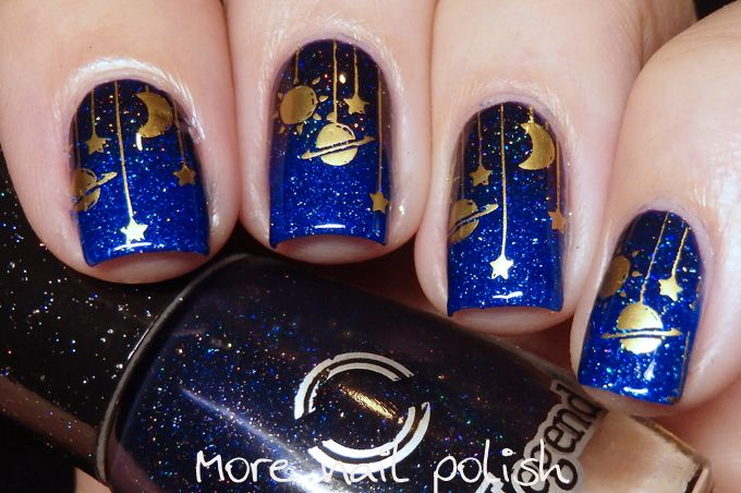 Dance Legend - Sparky Constellation nail art.  The Sparky Collection is a collection of six jelly polishes with a fine scattered holo effect.  Created a gradient with the two shades and then stamped using gold Mundo de Unas polish and the hanging constellations from BM-610.  One of the gradient  shades is 03 Aviator- A mid toned royal blue nail polish.