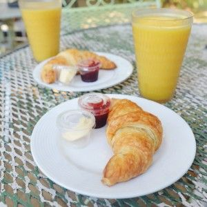 Vegan croissant with vegan butter, house-made jam and OJ from Thai Fresh.