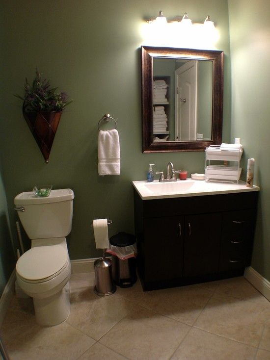Bathrooms tiled white vanity sage green walls basement for Bathroom decor green and brown