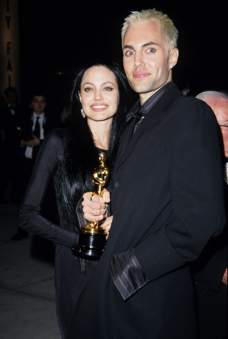Pin for Later: See How Angelina Jolie Transformed From Hollywood Bad Girl to Blushing Bride 2000 Angie famously kissed her brother, James Haven, when she won an Oscar for Girl, Interrupted.