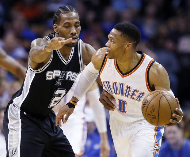 San Antonio's Kawhi Leonard (2) defends Oklahoma City's Russell Westbrook (0) during an NBA basketball game between the Oklahoma City Thunder and San Antonio Spurs at Chesapeake Energy Arena in Oklahoma City, Friday, March 31, 2017. Photo by Nate Billings, The Oklahoman
