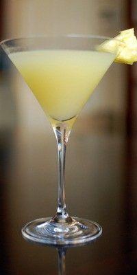 Cocktail recipe for a Caribbean Martini made with 1-1/2 ounces Absolut Mango vodka 3/4 ounce Malibu® coconut rum 1 splash pineapple juice Fresh pineapple chunks