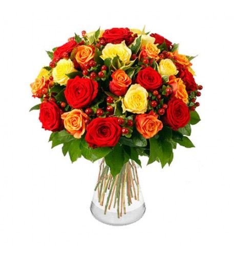 An amazing bouquet combining twelve red, eleven yellow and twelve cherry brandy roses. The two-tone cherry brandy roses echo the colours of the red and yellow roses and the hypericum berries, which are scattered throughout the bouquet, complement each rose colour.