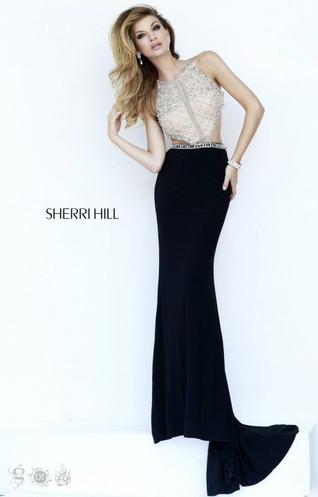 Sherri Hill 32069 is a dramatic gown that features a high neckline and a fitted bodice with asymmetrical beadwork that dazzle at any formal event. The side cut outs transition into the unique back that reveals side cut outs and more elegant beadwork. The figure flattering jersey skirt is ideal for prom, a pageant, formal gala or winter formal.