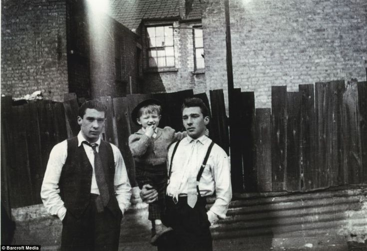 Backyard boys: family snap taken in Bethnal Green with older brother Charlie's son, Gary, the twins Ronnie (left) and Reggie Kray.