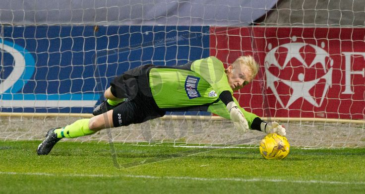 Queen's Park's keeper Marc Waters saves another penalty during the IRN-BRU Cup game between Partick Thistle Colts and Queen's Park
