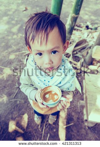 Thai  baby boy holding coffee cup
