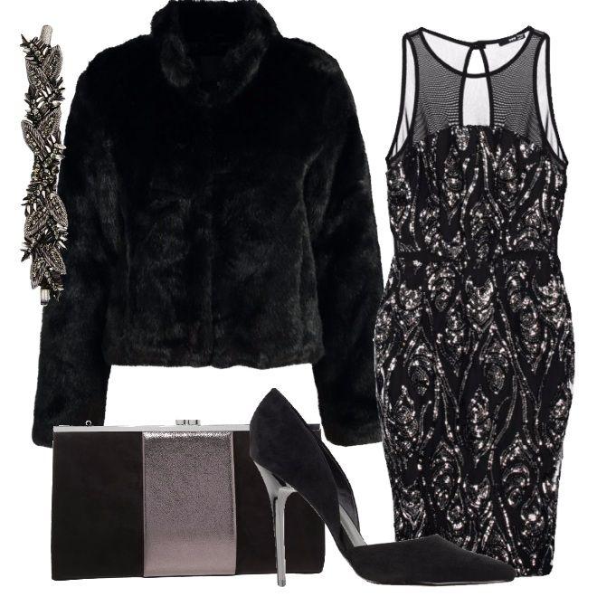 Un outfit per la sera, una cena romantica, una festa elegante. L'abito è sicuramente l'indumento principale, un tubino nero ricoperto di paillettes argentate. Tutti gli accessori sono più sobri e richiamano i colori nero e argento dell'abito. Da abbinare con una calda pelliccia corta per non coprire completamente il vestito.