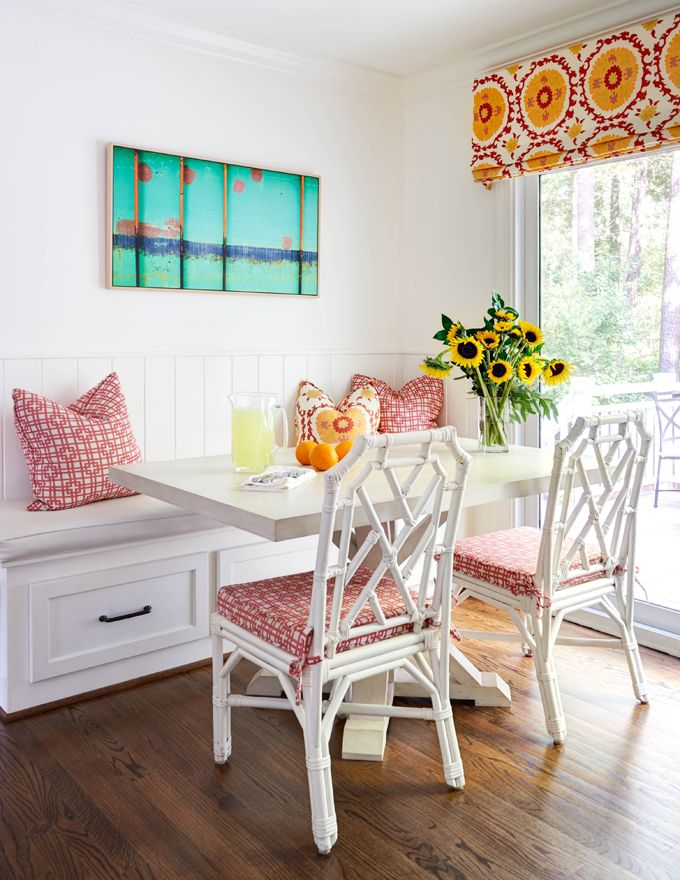 Classic Breakfast Room With White Built In Bench Seat, Gray Cushion, Gray  Pedestal Table, White Painted Wicker Chairs, Red And White Patterned  Cushions