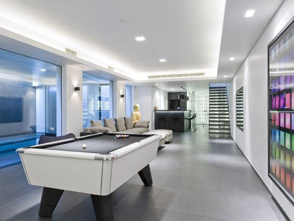 Buy a glassy london mansion with an indoor swimming pool for Indoor game room ideas