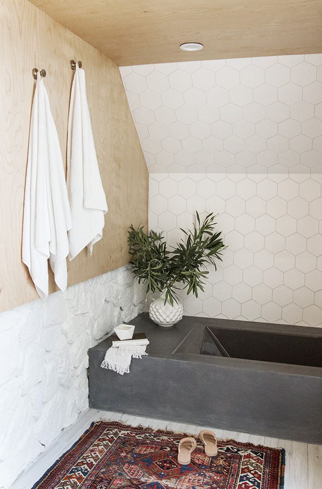 Very cool bathroom with plywood and tiles.