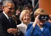S President Barack Obama and German Chancellor Angela Merkel visit the ifm electronics stand at hall 9 at the Hannover Messe industrial trade fair on...