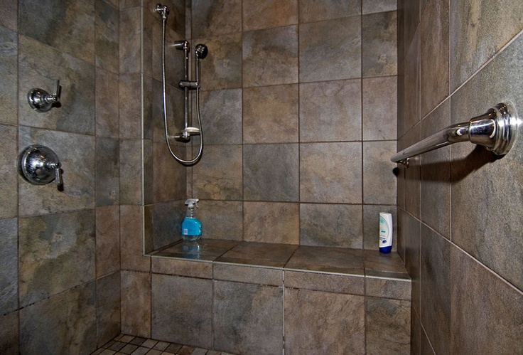 The ceramic tiled walkin shower is large to a