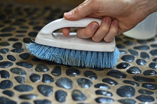 You might expect to get grimy feet from walking barefoot along a pebbly beach -- but not from your shower floor. A clean pebble shower floor welcomes you with sanitary, smooth, nubby stones to massage tired, achy feet. As long as the pebble tiles were installed correctly and the pebbles and grout were finished properly with sealer, they're...