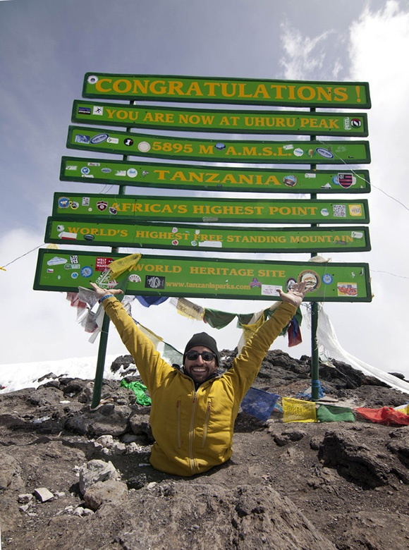 Spencer West on the summit of Mt. Kilimanjaro