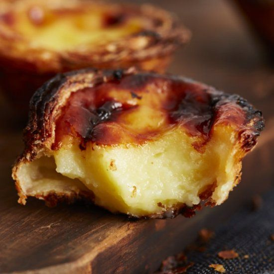 Authentic Portugese Custard Tart recipe. Use the tips to make perfectly crispy and browned tarts.