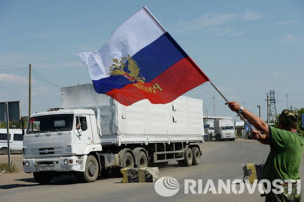 100%™ A column of Kamaz trucks carrying Russian humanitarian aid for the people of south-eastern regions of Ukraine passed the Ukrainian Izvarino border checkpoint and heads towards Luhansk.