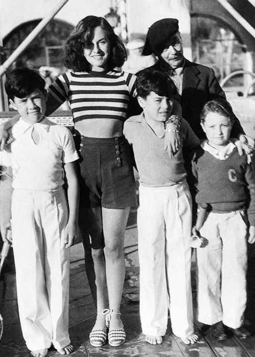 """chaplinfortheages: """" trixiedelight: """" Paulette Goddard and H.G. Wells with Charlie Chaplin's sons and friend, 1935 """" Charlie Jr 10 years old to Paulette's right & Sydney 9 to her left. They really loved Paulette, she was like a second mother to..."""