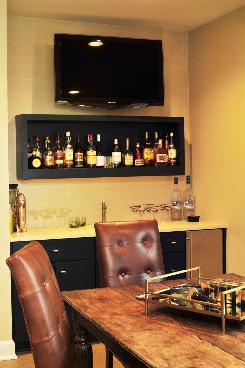 We love this simple sophisticated man cave dining area for Dining room bar ideas