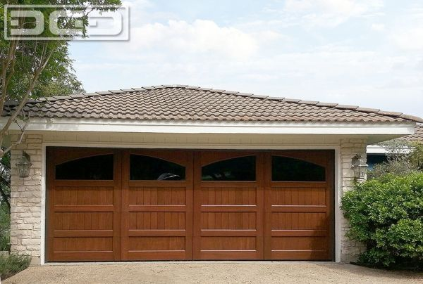 Custom Wood Garage Doors Made in Orange County, CA & Shipped Nationwide. Call (855) 343-3667 for custom garage door prices. by DynamicGarageDoors