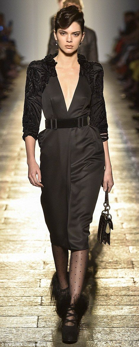 A striking sight: Kendall sported a retro-style hair style and plunging dress as she led the models out on the Bottega Veneta catwalk on Saturday