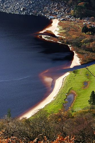 Guinness Lake is aptly named for its dark color, and with its white sand sitting at the top makes it look like a foaming pint of Ireland's finest. Wicklow Mountains, County Wicklow, Ireland