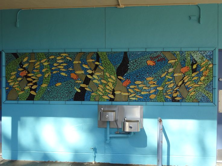 """""""School Days"""" created by the 5th grade graduating class. Senoritas schooling in a kelp forrest of the Monterey Bay with Geribaldi. Hand built ceramic fish and ceramic tile."""