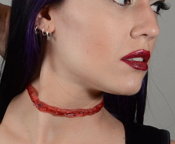 Slit Throat with blood by VonErickson, Von Erickson Laboratories ,purveyors of all sorts of original gothic spooky jewelry . It's what all the graveyard groupies are wearing this season!